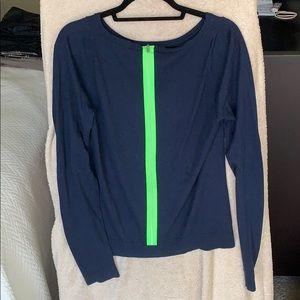 Navy Diane von Furstenburg sweater with neon green
